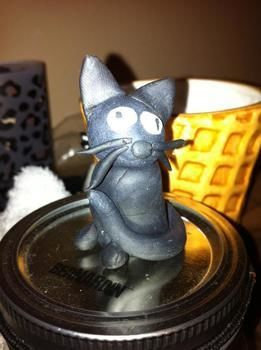 Cats! .  Sculpt a clay cat in under 40 minutes using clay. Inspired by creatures. Creation posted by Penny F. Difficulty: Easy. Cost: Cheap.