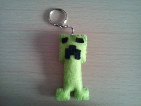 Your own pet Creeper! .  Sew a fabric character charm in under 30 minutes by sewing with fabric, felt, and felt. Inspired by monsters, clothes & accessories, and minecraft. Creation posted by iscrafte. Difficulty: Easy. Cost: Absolutley free.