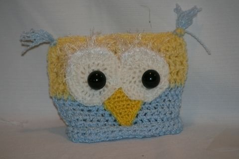 My lil owl hat .  Make an animal hat in under 50 minutes by crocheting with sewing needle. Inspired by birds and owls. Creation posted by Jodi F. Difficulty: Easy. Cost: 3/5.