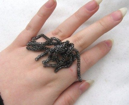 Wave goodbye with 'snakes'.  .  Make a chain ring in under 180 minutes by constructing, jewelrymaking, and wireworking with scissors, wire, and chain. Inspired by gothic, vintage & retro, and snakes. Creation posted by DarkAshHurts. Difficulty: 3/5. Cost: 3/5.