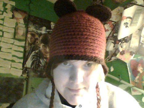 Red Panda Ear-Flap Hat .  Make an animal hat by crocheting with scissors, crochet hook, and worsted weight yarn. Inspired by christmas, costumes & cosplay, and kawaii. Creation posted by AeydenOrion. Difficulty: Easy. Cost: Cheap.