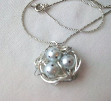 A simple sweet nest, perfect for mothers! .  Make a wire necklace in under 150 minutes by jewelrymaking, wireworking, and wireworking with beads, pliers, and permanent marker. Inspired by bird nests and bird nests. Creation posted by Margo T. Difficulty: 3/5. Cost: Cheap.