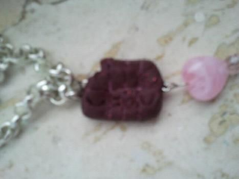 Hey! somebody took a bite out of it .  Free tutorial with pictures on how to sculpt a clay food necklace in under 10 minutes by beading with polymer clay. Inspired by kawaii. How To posted by ~-*animelover~-*. Difficulty: Easy. Cost: Absolutley free. Steps: 6