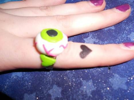 Turn your old ugly rings into something cool with Fimo! .  Make a clay ring in under 60 minutes by jewelrymaking and molding with polymer clay, oven, and sculpting tools. Inspired by halloween, zombies, and costumes & cosplay. Creation posted by Bloo Rayne. Difficulty: Easy. Cost: Absolutley free.