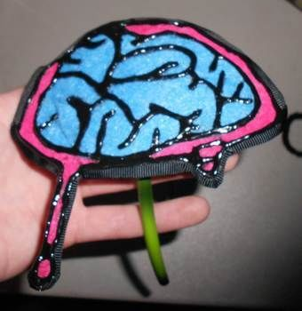 All zombies have brains. .  Make an applique headband in under 60 minutes by applying makeup with felt, ribbon, and hot glue gun. Inspired by zombies, costumes & cosplay, and monsters. Creation posted by Bloo Rayne.  in the Jewelry section Difficulty: Easy. Cost: Absolutley free.