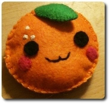 Handmade kawaii orange. My first felt creation using blanket stitch :) .  Make an orange plushie in under 30 minutes by needleworking and sewing with felt, needle, and fabric scissors. Inspired by kawaii and orange. Creation posted by DiscoRhombus. Difficulty: Simple. Cost: Cheap.