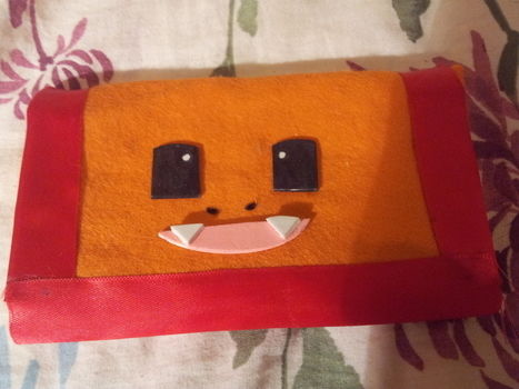 Made for a pokemon swap! .  Sew a fabric character pouch in under 150 minutes by needleworking and sewing with fabric, felt, and ribbon. Inspired by pokemon and nintendo. Creation posted by Hayley S. Difficulty: Easy. Cost: Absolutley free.