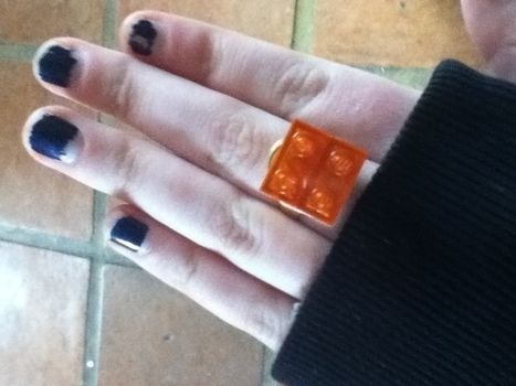 A treat for the fingers! .  Make a LEGO ring in under 10 minutes using beads, hot glue gun, and ring. Inspired by lego and clothes & accessories. Creation posted by spookycutie. Difficulty: Easy. Cost: Absolutley free.