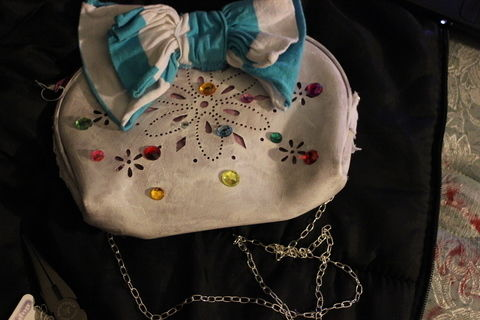 Curiouser and curiouser.  .  Free tutorial with pictures on how to sew a bow clutch in under 40 minutes by decorating, embellishing, and not sewing with chain, paint brush, and fabric paint. Inspired by alice in wonderland. How To posted by Supernova's Child. Difficulty: Simple. Cost: No cost. Steps: 4