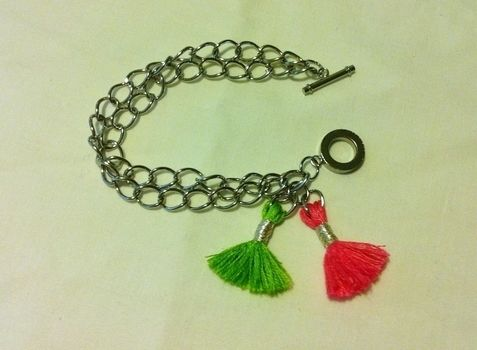 Fun Tassels For Your Writs! .  Free tutorial with pictures on how to make a bracelet in under 20 minutes by jewelrymaking with scissors, thread, and jump rings. Inspired by kawaii and clothes & accessories. How To posted by Pam. Difficulty: Easy. Cost: Absolutley free. Steps: 7