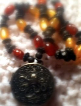 This necklace pretty much screams pirate! .  Make a locket in under 20 minutes by beading and jewelrymaking with beads, clasps, and fishing line. Inspired by creatures, pirate, and octopuses. Creation posted by Spyraleyes. Difficulty: Easy. Cost: Absolutley free.