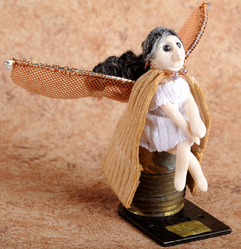 Isn't she just too cute? .  Sculpt a clay fairy in under 150 minutes by decorating with beads, wire, and clay. Inspired by fairies. Creation posted by Liz C. Difficulty: 4/5. Cost: 3/5.