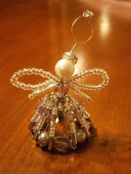Beautiful Beaded Angel Christmas Tree Decoration .  Make an angel in under 60 minutes by beading with beads, safety pins, and beading wire. Inspired by christmas and angels. Creation posted by Stalking Is Fun. Difficulty: 3/5. Cost: 3/5.
