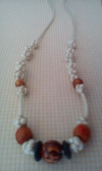 Chinese knots and beads <3 .  Braid a necklace in under 150 minutes by beading and knotting with beads, cord, and cord ends. Inspired by chinese and clothes & accessories. Creation posted by Feng. Difficulty: 4/5. Cost: Cheap.