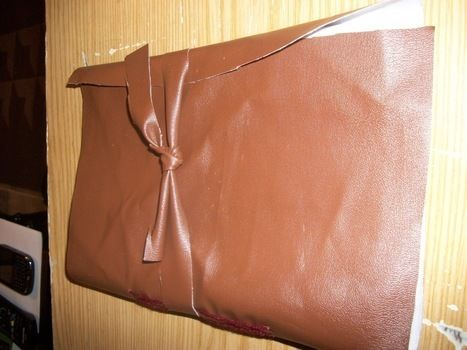Book, Sewing .  Free tutorial with pictures on how to make a leather journal in under 90 minutes by bookbinding and sewing with paper, needle, and string. Inspired by christmas. How To posted by VampGirl. Difficulty: 3/5. Cost: 3/5. Steps: 7
