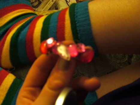 A cute use for any nail polish gems (hint hint) .  Embellish a bejewelled hair clip in under 10 minutes by embellishing with hot glue gun, hair clips, and gems. Inspired by clothes & accessories. Creation posted by Supernova's Child. Difficulty: Easy. Cost: No cost.