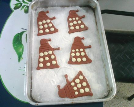 Dr who ,daleks ,cookies, cookie cutter .  Free tutorial with pictures on how to decorate a character cookie in under 50 minutes by cooking with flour, chocolate chips, and design. Inspired by dr who, geeky, and vintage & retro. Recipe posted by Cecy C. Difficulty: Easy. Cost: Cheap. Steps: 6