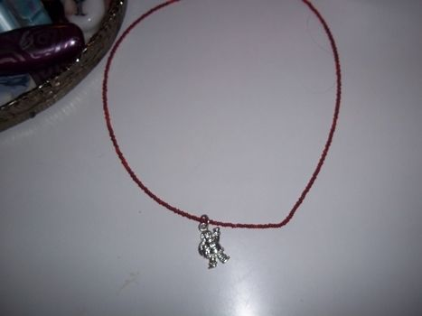 Ho ho ho .  Make a necklace in under 20 minutes by jewelrymaking with pendant. Inspired by christmas and santa claus. Creation posted by Ashley P. Difficulty: Easy. Cost: Absolutley free.