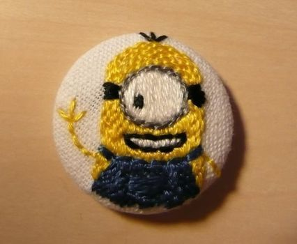 BANANA! .  Stitch a stitched brooch in under 40 minutes by embroidering and cross stitching with embroidery floss, embroidery needle, and pin back buttons. Inspired by despicable me and clothes & accessories. Creation posted by Käpt´n Toasterkopf. Difficulty: Simple. Cost: Cheap.