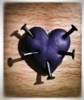 Nailed Anti Valentines Heart .  Sculpt a clay shape necklace in under 60 minutes by molding and  with polymer clay, eye pins, and tacks. Inspired by valentine's day, hearts, and hearts. Creation posted by Zombiella x. Difficulty: Easy. Cost: Absolutley free.