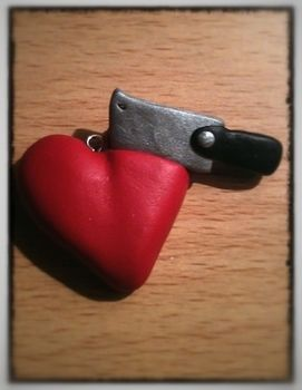 Is that a meat cleaver in my heart .  Sculpt a clay shape necklace in under 60 minutes by molding and  with polymer clay and eye pins. Inspired by valentine's day, hearts, and hearts. Creation posted by Zombiella x. Difficulty: Easy. Cost: No cost.