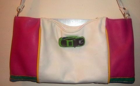 Turn an old license plate into a fashionable purse .  Free tutorial with pictures on how to make a recycled bag in under 90 minutes by decorating, embellishing, and sewing with sewing machine, ribbon, and needle. Inspired by crafts. How To posted by KMOM14. Difficulty: Easy. Cost: No cost. Steps: 6