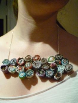 Fashion from the trash .  Make a magazine necklace in under 120 minutes by jewelrymaking and papercrafting with hot glue gun, chain, and magazine. Inspired by crafts and clothes & accessories. Creation posted by Super Dooper. Difficulty: Simple. Cost: No cost.