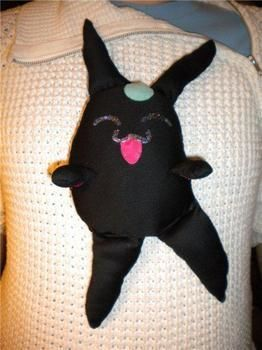 A cute dancing black mokona .  Make a Pokemon plushie by sewing and dressmaking with thread, needle, and cotton. Inspired by monsters, kawaii, and mokona. Creation posted by Kitiara. Difficulty: Simple. Cost: Cheap.