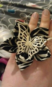 Kanzashi butterfly ring. .  Make a fabric ring in under 60 minutes by constructing, decorating, embellishing, jewelrymaking, needleworking, sewing, and sewing with fabric, felt, and glue gun. Inspired by gothic, costumes & cosplay, and vintage & retro. Creation posted by Hallucinogenic_lipstick. Difficulty: Easy. Cost: Cheap.