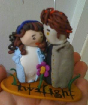 Clay Bella and Edward Ornament  .  Mold a clay character by molding and decorating with acrylic paint, polymer clay, and oven. Inspired by christmas and twilight. Creation posted by Jessica P. Difficulty: 4/5. Cost: 3/5.