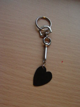 <3 For the musical love of your life <3 .  Make a recycled charm in under 20 minutes by jewelrymaking with scissors, permanent marker, and nail file. Inspired by valentine's day. Creation posted by Claire J. Difficulty: Easy. Cost: No cost.