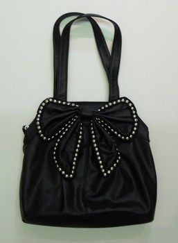 Make a boring bag look instantly expensive and edgy. .  Free tutorial with pictures on how to sew a bow bag in under 30 minutes by embellishing, studding, and metalworking with ribbon, pliers, and studs. Inspired by punk and clothes & accessories. How To posted by Cutie Boots. Difficulty: Simple. Cost: Cheap. Steps: 3