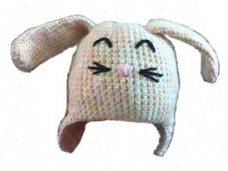 Sweet babies in cold climates get to have twee hats!! .  Make an animal hat by yarncrafting and crocheting with baby yarn. Inspired by babies, rabbits, and kawaii. Creation posted by Amanda. Difficulty: 3/5. Cost: Cheap.