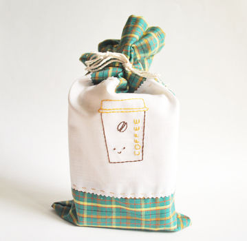 Make a simple gift of a bag of coffee extra special with a little hand-stitched bag! .  Free tutorial with pictures on how to make a pouch, purse or wallet in under 60 minutes by sewing with fabric, thread, and ribbon. How To posted by Mollie J. Difficulty: Simple. Cost: Cheap. Steps: 7