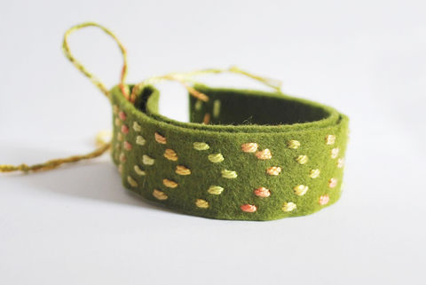 A quicker way to stitch up a friendship bracelet! .  Free tutorial with pictures on how to make a fabric cuff in under 60 minutes by jewelrymaking and embroidering with scissors, felt, and needle. How To posted by Mollie J. Difficulty: Simple. Cost: Absolutley free. Steps: 4