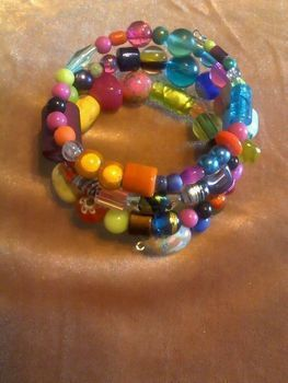Fun an funky anytime wear .  Make a memory wire bracelet in under 10 minutes by beading and jewelrymaking with beads, wire cutters, and memory wire. Inspired by clothes & accessories. Creation posted by Ladyblackwolfe. Difficulty: Easy. Cost: 3/5.