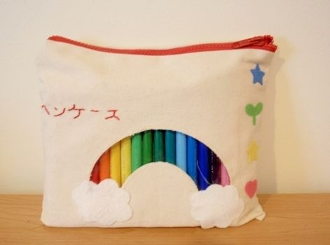 Make school/work a happier place .  Make a pouch, purse or wallet in under 90 minutes by embroidering and sewing with felt, embroidery thread, and zipper. Inspired by japanese, kawaii, and rainbow. Creation posted by Gabrielle. Difficulty: Simple. Cost: Cheap.