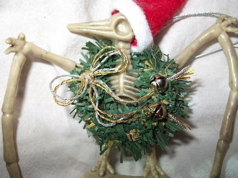 Nothing says Christmas like a dinosaur on your tree!  .  Make a bauble in under 60 minutes by constructing, decorating, and felting with felt, hot glue gun, and string. Inspired by christmas, gothic, and monsters. Creation posted by Jessy. Difficulty: Easy. Cost: Absolutley free.