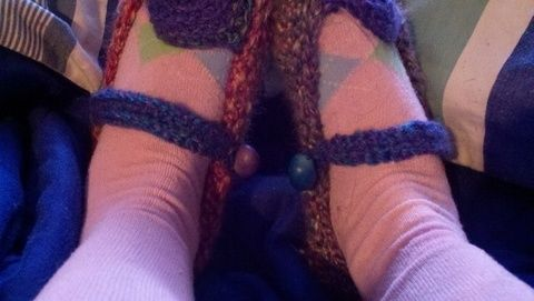 Crochet slippers  .  Stitch a pair of knit or crochet slippers in under 150 minutes by sewing, yarncrafting, and crocheting with crochet hook, wooden beads, and fuzzy yarn. Inspired by crafts, cut out + keep, and clothes & accessories. Creation posted by RastaMobileHemp. Difficulty: Simple. Cost: Cheap.