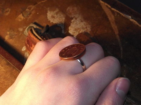 Yes I know, it looks a bit cheap!! .  Make a coin ring in under 10 minutes by jewelrymaking with ring base and penny. Inspired by clothes & accessories. Creation posted by Georgia . Difficulty: Simple. Cost: Absolutley free.