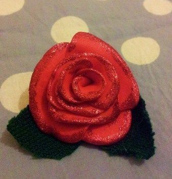 Made for the valentines swap :) .  Mold a clay flower in under 60 minutes by decorating with fabric, hot glue gun, and polymer clay. Inspired by valentine's day and flowers. Creation posted by Hayley S. Difficulty: 3/5. Cost: Cheap.