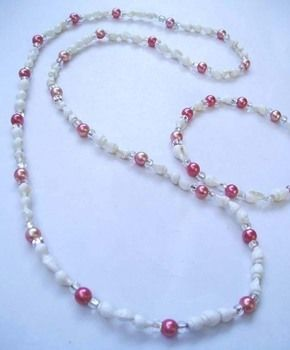 Necklace and Bracelet made of Sea Shells and Pink Pearls .  Make a pearl necklace in under 30 minutes by beading with pearls, beading wire, and shell. Creation posted by gee G. Difficulty: Simple. Cost: Cheap.
