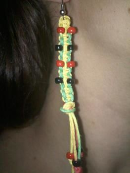 Rasta earrings  .  Braid a set of braided earrings in under 10 minutes by knotting with beads, earring hooks, and hemp string. Inspired by clothes & accessories. Creation posted by alexoid a. Difficulty: Easy. Cost: No cost.