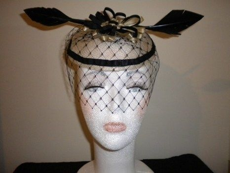Cream Fascinator with Black Arrow Feathers .  Make a fascinator by paper folding with white glue, white glue, and satin ribbon. Inspired by clothes & accessories. Creation posted by Rose. Difficulty: 3/5. Cost: 3/5.