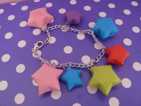 Some of the bracelets i have made with paper stars!!  .  Make a paper bracelet in under 15 minutes by jewelrymaking, paper folding, and paper folding with paper and jewelry chain. Inspired by kawaii and stars. Creation posted by Ria. Difficulty: Easy. Cost: Absolutley free.
