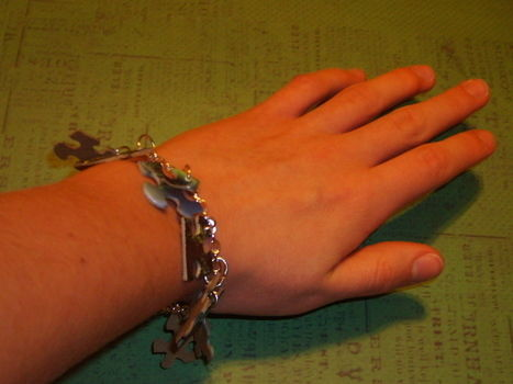 Nice, cute, puzzle piece bracelet .  Free tutorial with pictures on how to recycle a puzzle piece bracelet in under 40 minutes by jewelrymaking with needle, chain, and clasps. Inspired by clothes & accessories. How To posted by Sammi C. Difficulty: Simple. Cost: Cheap. Steps: 9