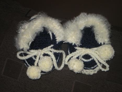 Babies handcrocheted moccasin slippers .  Stitch a pair of knit or crochet slippers by crocheting with fibre. Inspired by clothes & accessories. Creation posted by Cecelia H. Difficulty: Easy. Cost: Cheap.