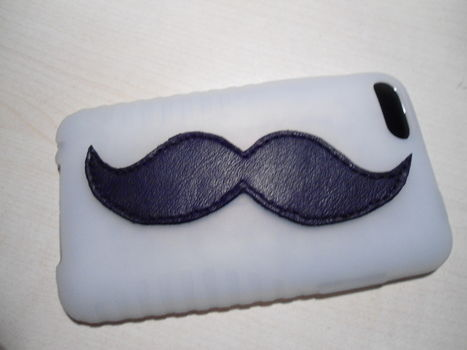 Want to Mustache up your day? This case will do just that :) .  Free tutorial with pictures on how to make a phone case in under 120 minutes by decorating, embellishing, sewing, and not sewing with scissors, thread, and needle. Inspired by ipod. How To posted by Philippe T. Difficulty: Simple. Cost: Cheap. Steps: 8