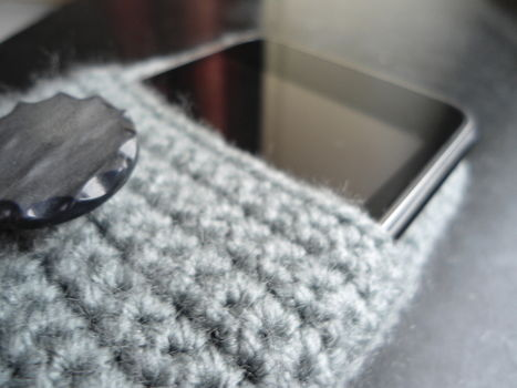 Safe cozy for your awesome device! .  Stitch a knit or crochet pouch in under 180 minutes by needleworking, sewing, and crocheting with yarn and crochet hook. Inspired by camera and ipod. Creation posted by Philippe T. Difficulty: Simple. Cost: Cheap.