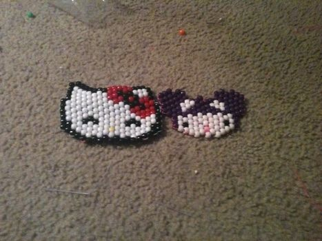 Hello Kitty wearing a Deadmau5 hat and Hello Kitty .  Make a beaded animal in under 131 minutes by beading and beading with pony beads. Inspired by hello kitty, cats, and deadmau5. Creation posted by XxHello-KittixX. Difficulty: 3/5. Cost: Cheap.